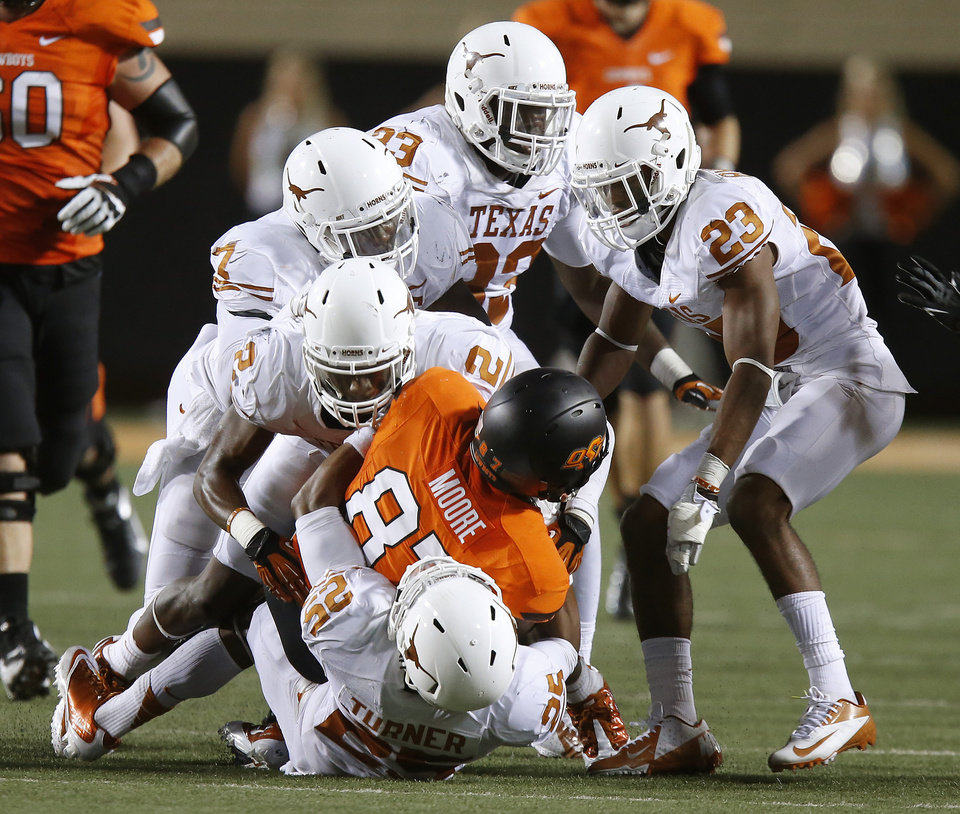 Oklahoma State's Tracy Moore (87) is brought down by a group of Texas defenders during a college football game between Oklahoma State University (OSU) and the University of Texas (UT) at Boone Pickens Stadium in Stillwater, Okla., Saturday, Sept. 29, 2012. Oklahoma State lost 41-36. Photo by Bryan Terry, The Oklahoman