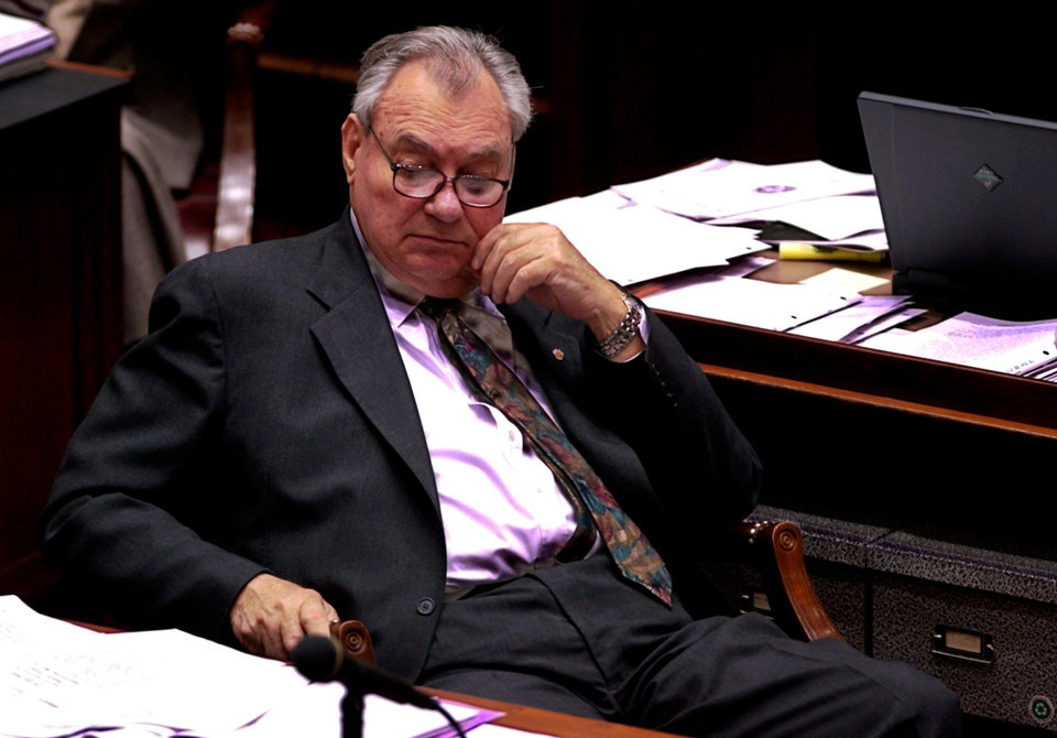 Photo - RESIGN, RESIGNATION: Gene Stipe sits in the Senate chambers on the day he resigned his seat.  Staff Photo by Steve Sisney