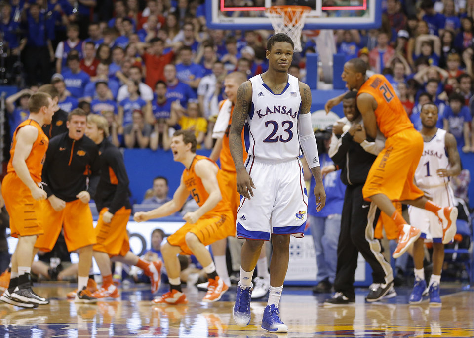 Photo - Kansas' Ben McLemore (23) walks off the court after the Jayhawks upset, 85-80, by Oklahoma State at Allen Fieldhouse in Lawrence, Kansas, on Saturday, February 2, 2013. (Travis Heying/Wichita Eagle/MCT)