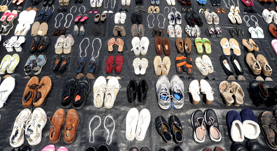 Photo -   An exhibit of shoes in remembrance of people who have jumped from the Golden Gate Bridge is displayed during a commemoration of the bridge's 75th anniversary on Sunday, May 27, 2012, in San Francisco. The Bridge Rail Foundation, which advocates for a safety net along the span to prevent suicides, estimates approximately 1,558 people have died after jumping since the bridge opened. (AP Photo/Noah Berger)