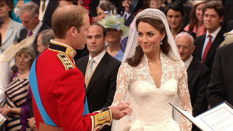 Photo - In this image taken from video, Britain's Prince William, left, takes the hand of his wife, Kate, the Dutchess of Cambridge, as they stand at the altar at Westminster Abbey for the Royal Wedding in London on Friday, April, 29, 2011. (AP Photo/APTN) EDITORIAL USE ONLY NO ARCHIVE PHOTO TO BE USED SOLELY TO ILLUSTRATE NEWS REPORTING OR COMMENTARY ON THE FACTS OR EVENTS DEPICTED IN THIS IMAGE ORG XMIT: RWVM175