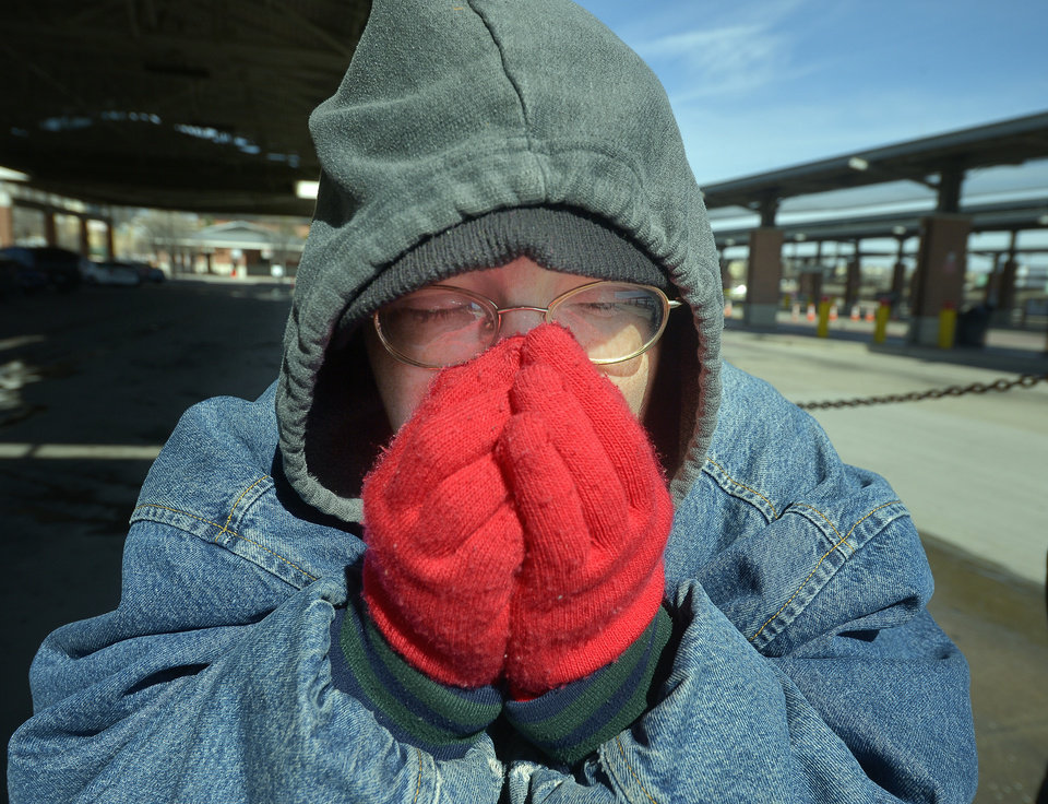 Photo - Dana Maxwell tries to keep warm at Intermodal Transportation Center in Fort Worth, Texas, Monday, March 3, 2014.  The couple said that they are homeless and had to leave the Presbyterian Night Shelter at 7 a.m. and plan to ride the bus all day to keep warm.  The National Weather Service issued a wind chill advisory until midmorning Monday for the Dallas-Fort Worth area. Forecasters say sunny conditions should return by Tuesday with highs in the upper 40s. (AP Photo/The Fort Worth Star-Telegram, Max Faulkner)  MAGS OUT; (FORT WORTH WEEKLY, 360 WEST); INTERNET OUT