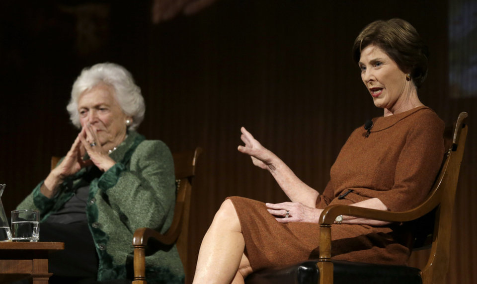 Former first ladies Barbara Bush, left, and Laura Bush, take part in the Enduring Legacies of America's First Ladies conference Thursday, Nov. 15, 2012, in Austin, Texas. Family members, former staff members, historians, and White House insiders also spoke as part of the program. (AP Photo/David J. Phillip)