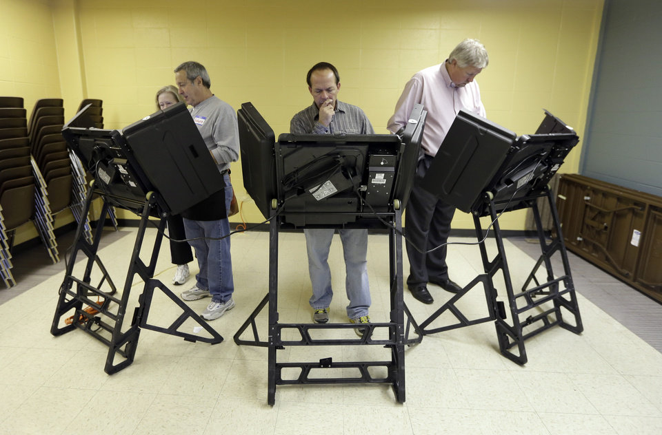 Photo -   Voters cast their ballots in the general election at Kirkwood Community Center Tuesday, Nov. 6, 2012, in Kirkwood, Mo. (AP Photo/Jeff Roberson)