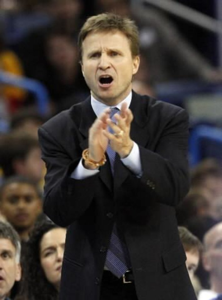 Oklahoma City Thunder interim head coach  Scott  Brooks calls to his players during the first quarter of an NBA basketball game against the New Orleans Hornets in New Orleans, Saturday, Nov. 22, 2008. AP Photo/Ann Heisenfelt