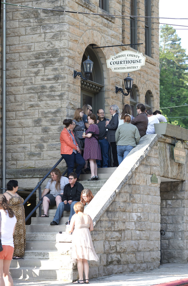 Photo - A line of same-sex couples waiting to apply for a marriage license forms at the Carroll County Courthouse Saturday, May 10, 2014, in Eureka Springs, Ark. A judge overturned amendment 83, Friday, which banned same-sex marriage in the state of Arkansas. (AP Photo/Sarah Bentham)