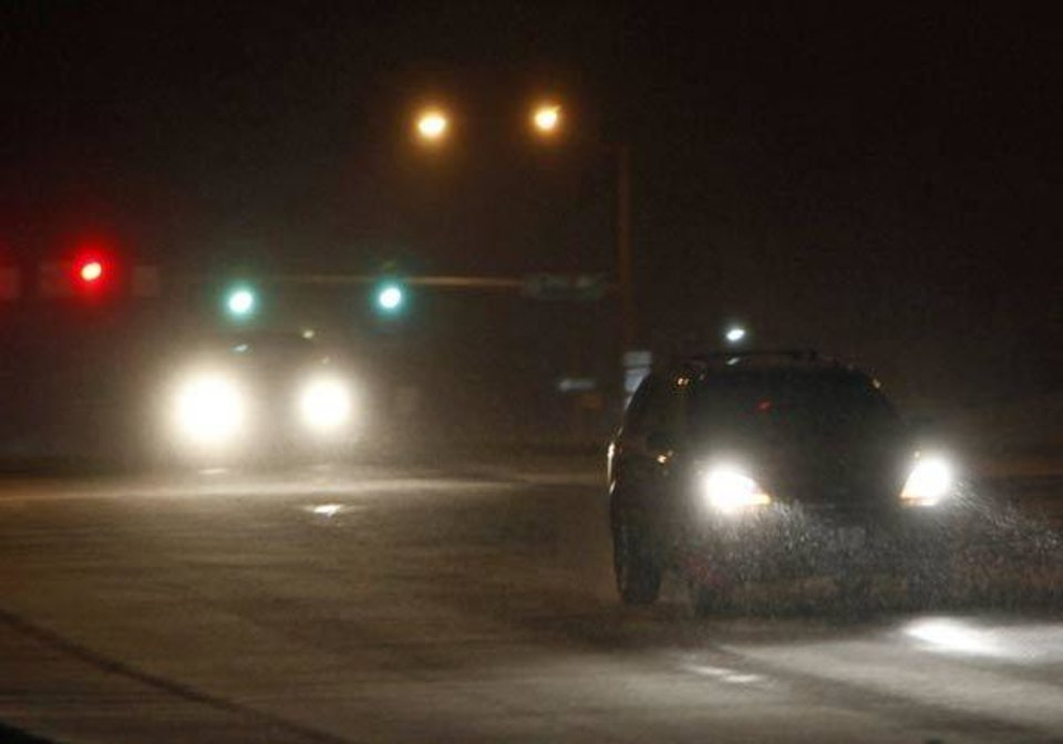 Sleet is shown in the headlights of a vehicle on Britton Rd. near Broadway in Oklahoma City, late Monday, January 31, 2011. Photo by Nate Billings, The Oklahoman