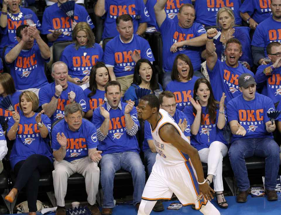 Photo - Oklahoma City fans celebrate after a basket by Oklahoma City's Kevin Durant during Game 7 in the first round of the NBA playoffs between the Oklahoma City Thunder and the Memphis Grizzlies at Chesapeake Energy Arena in Oklahoma City, Saturday, May 3, 2014. Photo by Sarah Phipps, The Oklahoman