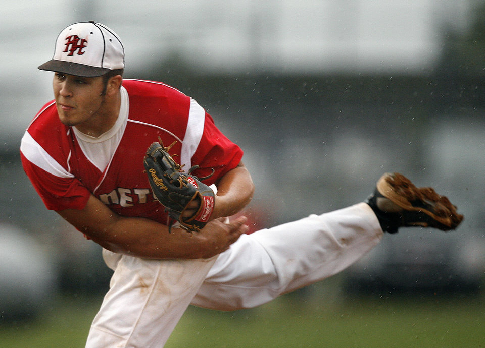 Photo - Hilldale's Dalton Cunningham throws a pitch during the 4A high school baseball playoff game between Hilldale and Anadarko at Shawnee High School in Shawnee, Okla., Friday, May 11, 2012. Photo by Sarah Phipps, The Oklahoman