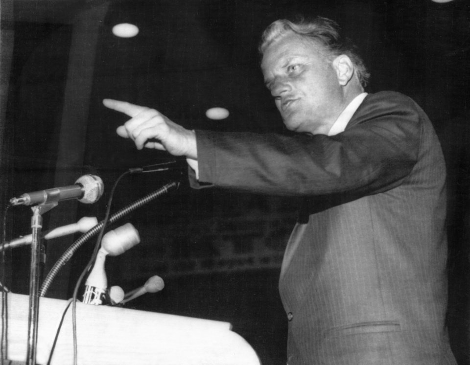 """Photo - 'OKLAHOMA CITY, 2/4/70----EVANGELIST SPEAKS TO OVERFLOW CROWD---  Billy Graham addressed more than 16,000 people at the state fair arena Tuesday night (2/3/70) during the inauguration services for the Agency for Christian Cooperative Ministry (in Oklahoma City).  It was his first appearance in Oklahoma City in 14 years."""" Staff photo by Joe Aker taken 2/3/70; photo ran in the 2/4/70 Oklahoma City Times and was also sent to the Associated Press. File:  Billy Graham/Oklahoma City/Visit/1970"""