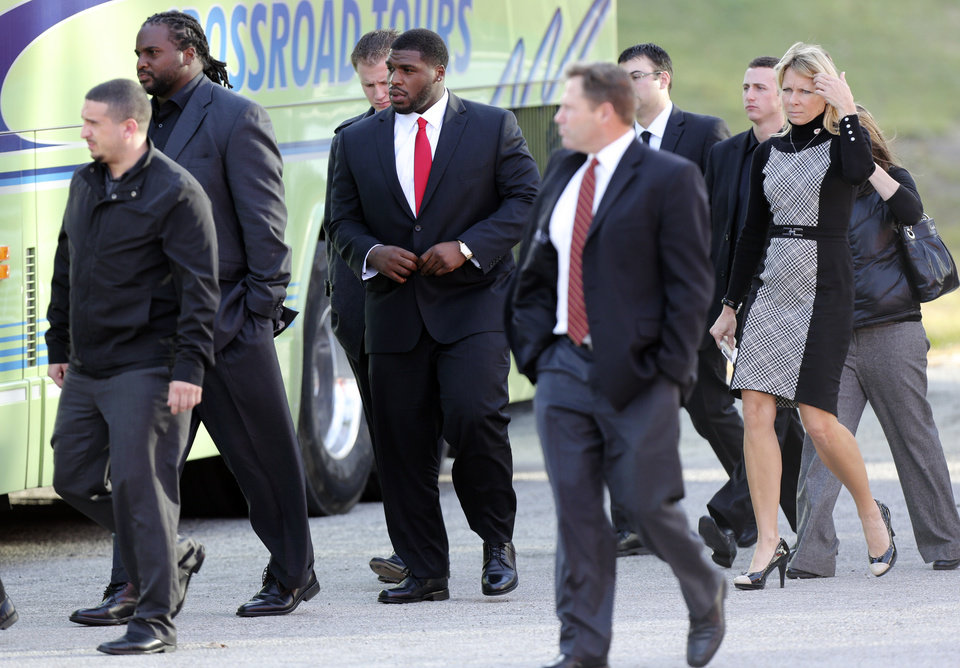 Kansas City Chiefs players and staff leave a memorial service for Jovan Belcher at the Landmark International Deliverance and Worship Center, Wednesday, Dec. 5, 2012, in Kansas City, Mo. Belcher shot his girlfriend, Kasandra Perkins, at their home Saturday morning before driving to Arrowhead Stadium and turning the gun on himself. (AP Photo/Ed Zurga)