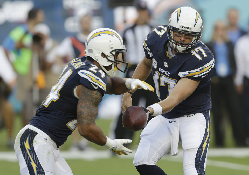 San Diego Chargers quarterback Philip Rivers (17) hands off the ball to running back Ryan Mathews (24) during the first half of an NFL football game against the Miami Dolphins, Sunday, Nov. 17, 2013, in Miami Gardens, Fla. (AP Photo/Wilfredo Lee)