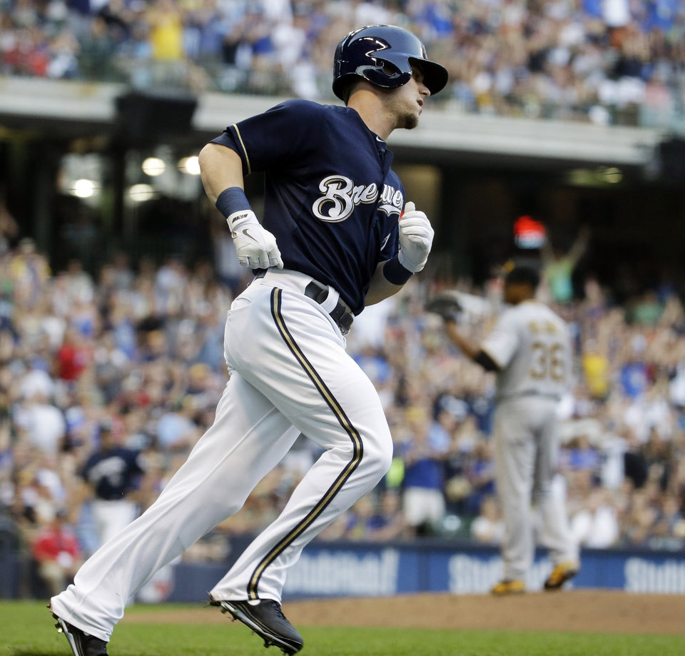 Photo - Milwaukee Brewers' Scooter Gennett rounds the bases after hitting a home run during the second inning of a baseball game against the Pittsburgh Pirates on Saturday, Aug. 23, 2014, in Milwaukee. (AP Photo/Morry Gash)
