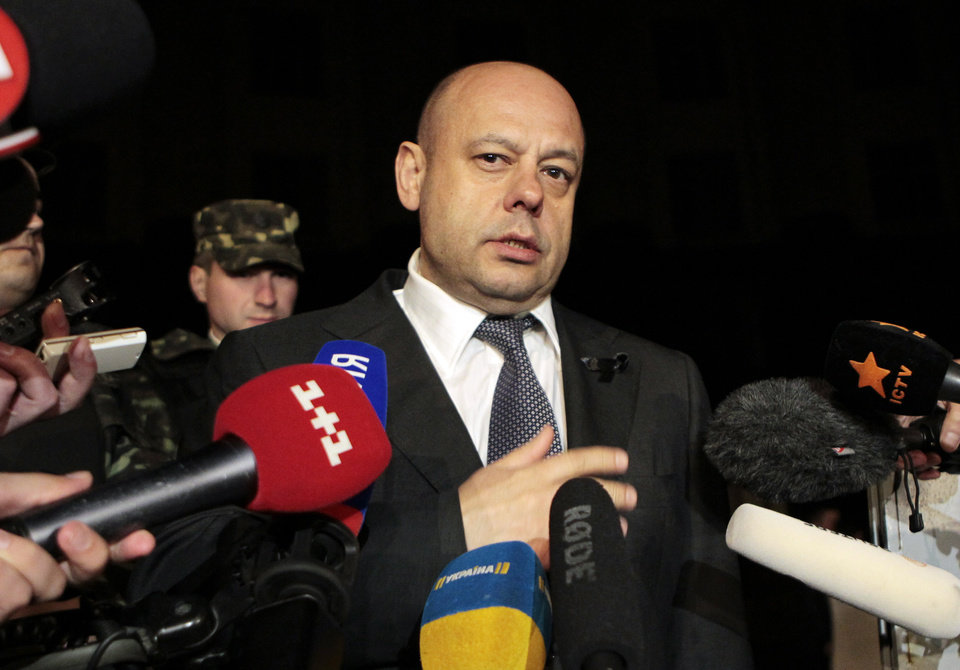Photo - Ukraine Energy Minister Yuriy Prodan to speak to reporters outside the government building in Kiev, Ukraine, Monday, June 16, 2014. A Monday deadline approached with no sign of progress in resolving a months-long dispute over exactly how much Ukraine owes Russia for past natural gas deliveries and what price the nation should pay for future supplies. (AP Photo/Sergei Chuzavkov)