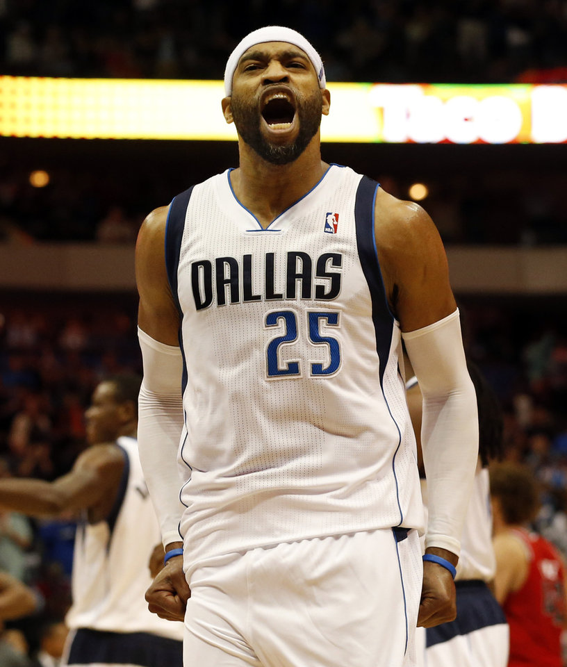 Photo - Dallas Mavericks guard/forward Vince Carter (25) shouts after scoring the final points of Dallas' 103-98 win in an NBA basketball game against the Portland Trail Blazers on Friday, March 7, 2014, in Dallas. (AP Photo/John F. Rhodes)