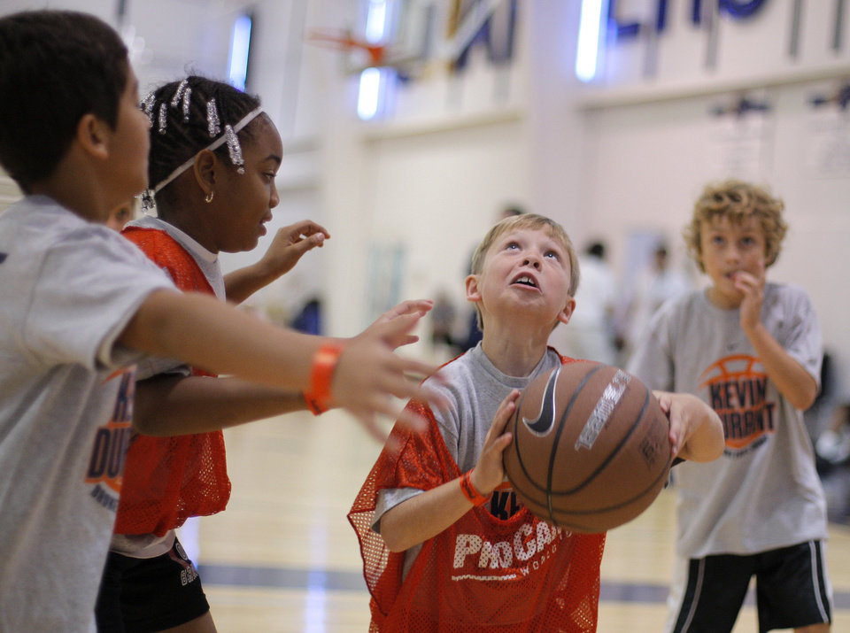 Ryan Jones, 7 of Tulsa, shoots a basketball during the Kevin Durant basketball camp at Heritage Hall Wednesday, June 29, 2011.  Photo by Garett Fisbeck, The Oklahoman