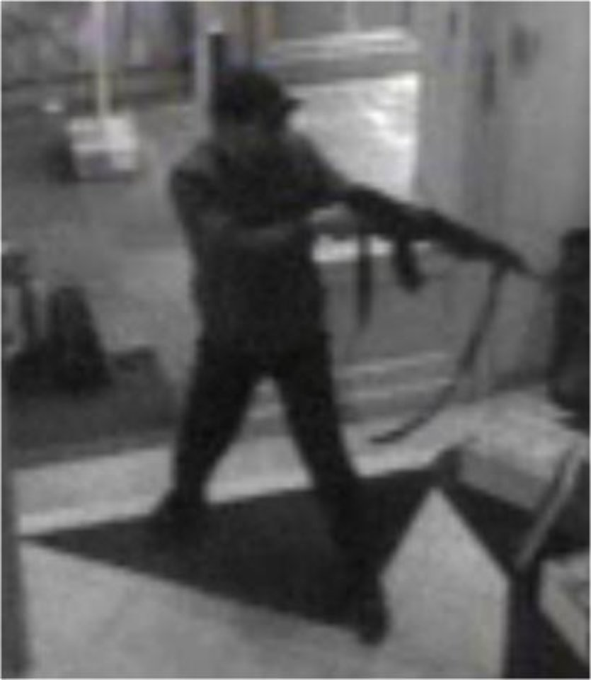 Photo - In this hand out photo distributed on Sunday, May 25, 2014 by the Belgian Federal Police, a surveillance camera shows a man shooting at the Jewish museum in Brussels, Belgium, on Saturday, May 24, 2014. Police stepped up security at Jewish institutions, schools and synagogues after three people were killed and one seriously injured in a spree of gunfire at the Jewish Museum in Brussels on Saturday. (AP Photo/Belgian Federal Police)