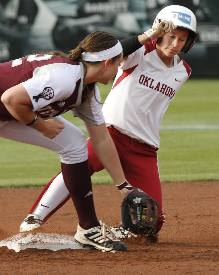 Brianna Turang is safe at second beating the tag by Jenna Stark during the NCAA Super Regional softball game as the University of Oklahoma (OU) Sooners defeats Texas A&M 10-2 at Marita Hines Field on Friday, May 24, 2013 in Norman, Okla. Photo by Steve Sisney, The Oklahoman