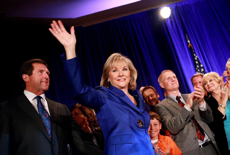 Photo - Governor elect of Oklahoma Mary Fallin and her husband Wade Christensen greet supporters as they are take the stage during the Republican Watch Party at the Marriott in Oklahoma City on Tuesday, Nov. 2, 2010.Photo by John Clanton, The Oklahoman