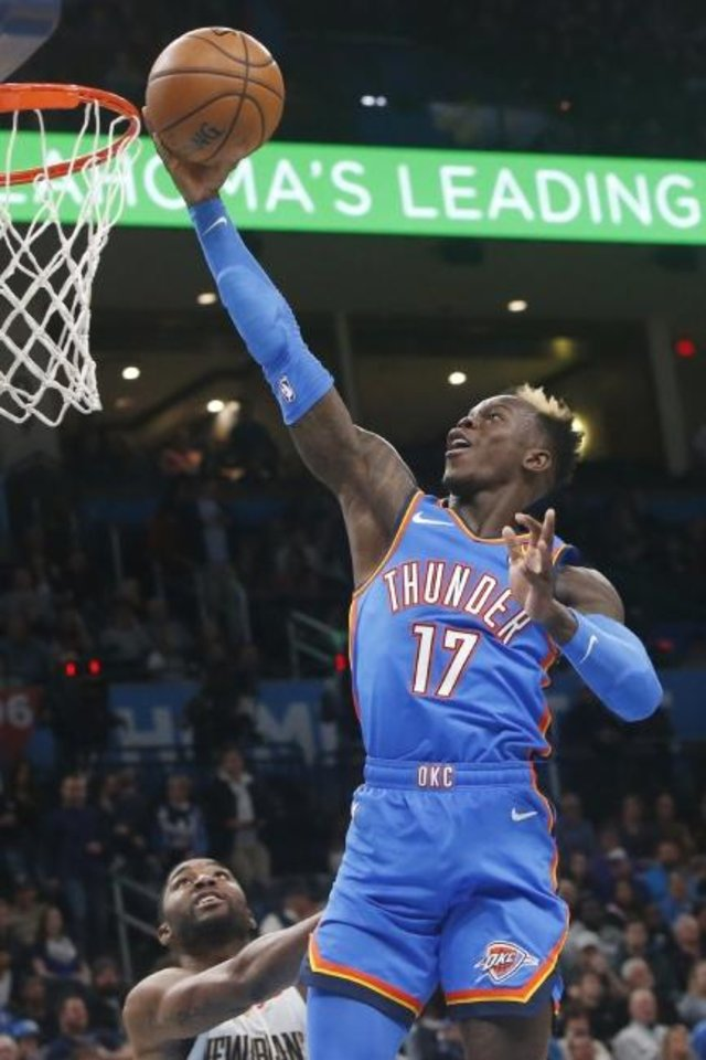 Photo -  Oklahoma City Thunder guard Dennis Schroeder goes to the basket in front of New Orleans Pelicans guard E'Twaun Moore during Friday night's game at Chesapeake Energy Arena. [AP Photo/Sue Ogrocki]