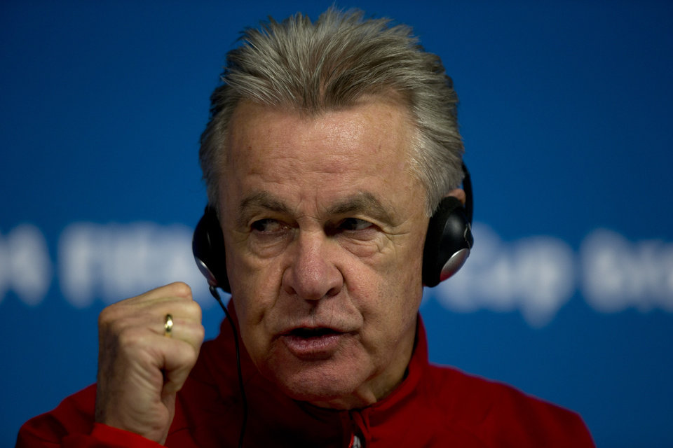 Photo - Switzerland's coach Ottmar Hitzfeld gestures during a news conference at Itaquerao Stadium in Sao Paulo, Brazil, Monday, June 30, 2014.  On Tuesday, Switzerland will face Argentina in their next World Cup soccer match. (AP Photo/Dario Lopez-Mills)