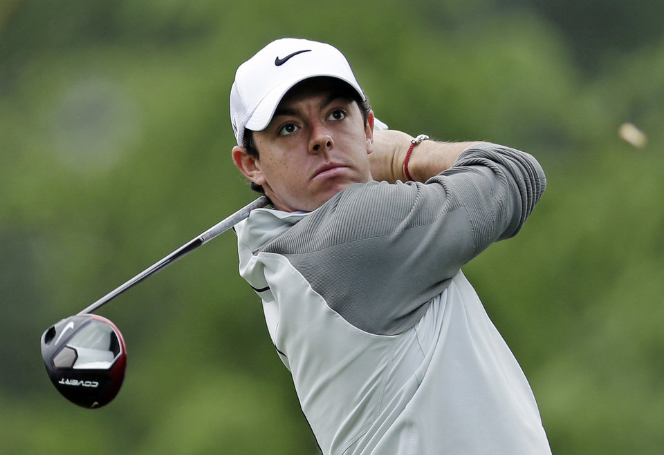 Photo - Rory McIlroy watches his tee shot on the 11th hole during the first round of the Wells Fargo Championship golf tournament in Charlotte, N.C., Thursday, May 1, 2014. (AP Photo/Chuck Burton)