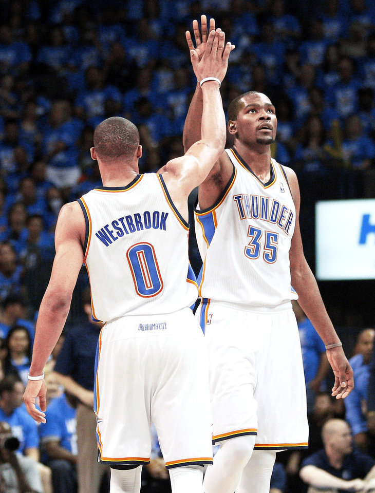 Russell Westbrook and Kevin Durant. Sue Ogrocki - AP