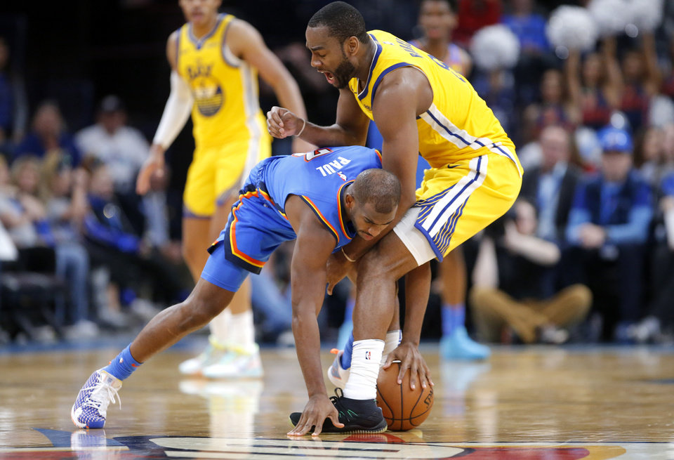 Photo - Oklahoma City's Chris Paul (3) tries to get a loose ball from Golden State's Alec Burks (8) during the NBA game between the Oklahoma City Thunder and the Golden State Warriors at Chesapeake Energy Arena,   Saturday, Nov. 9, 2019.  [Sarah Phipps/The Oklahoman]
