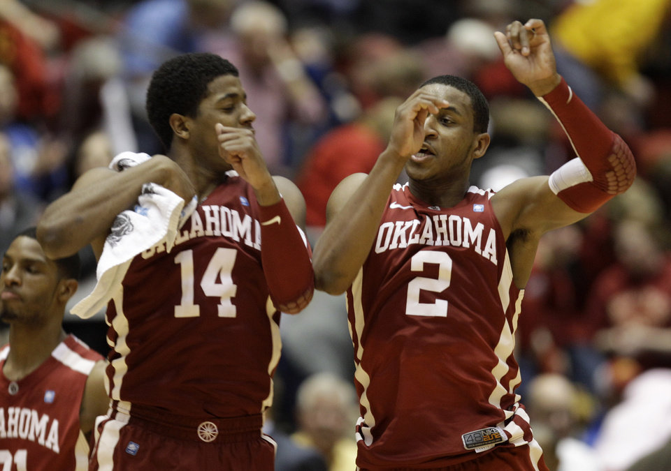 Oklahoma guard Steven Pledger, right, celebrates with teammate Carl Blair at the end of an NCAA college basketball game against Iowa State, Saturday, Jan. 29, 2011, in Ames, Iowa.  Pledger scored 38 points as Oklahoma won 82-76 in overtime. (AP Photo/Charlie Neibergall)