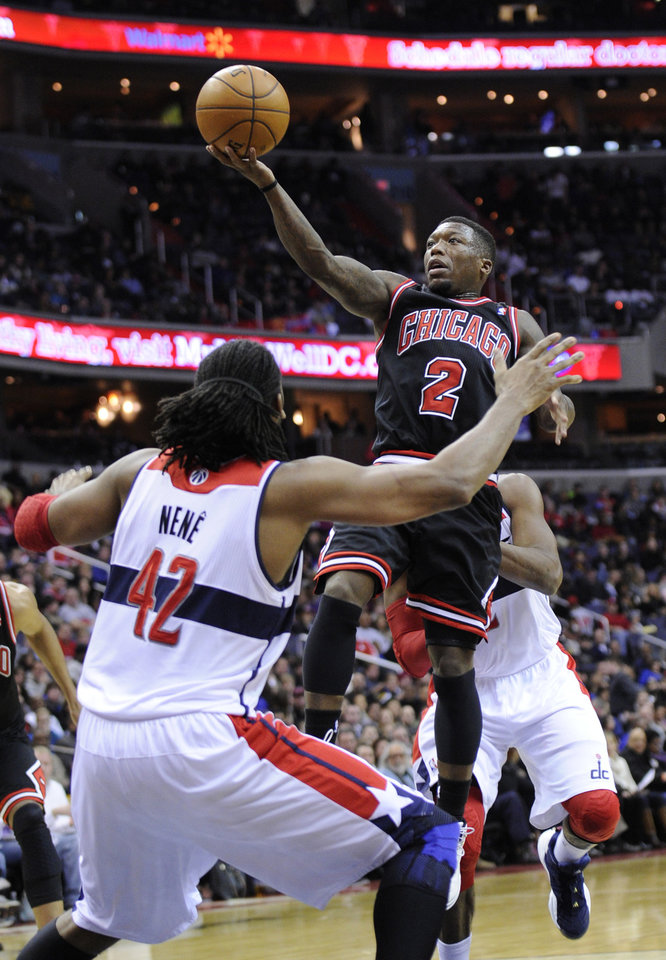 Chicago Bulls guard Nate Robinson (2) goes to the basket against Washington Wizards center Nene (42), of Brazil, during the first half of an NBA basketball game, Saturday, Jan. 26, 2013, in Washington. (AP Photo/Nick Wass)