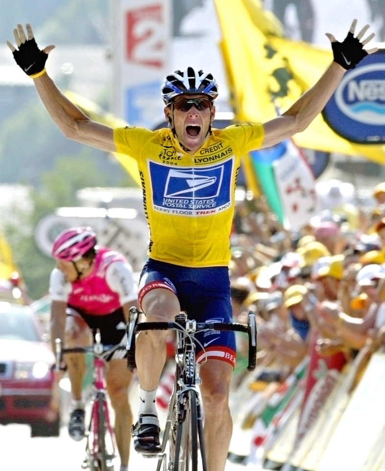 Photo - FILE - In this July 22, 2004, file photo, Lance Armstrong reacts as he crosses the finish line to win the 17th stage of the Tour de France cycling race between Bourd-d'Oisans and Le Grand Bornand, French Alps. In 2004, Armstrong was also named Associated Press Male Athlete of the Year and ESPN's ESPY Award for Best Male Athlete. (AP Photo/Laurent Rebours, File)