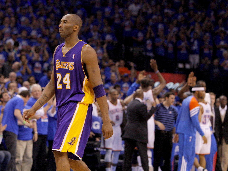 Photo - Los Angeles' Kobe Bryant (24) walks to the bench as Oklahoma City celebrates during Game 5 in the second round of the NBA playoffs between the Oklahoma City Thunder and the L.A. Lakers at Chesapeake Energy Arena in Oklahoma City, Monday, May 21, 2012. Oklahoma City won 106-90.  Photo by Bryan Terry, The Oklahoman