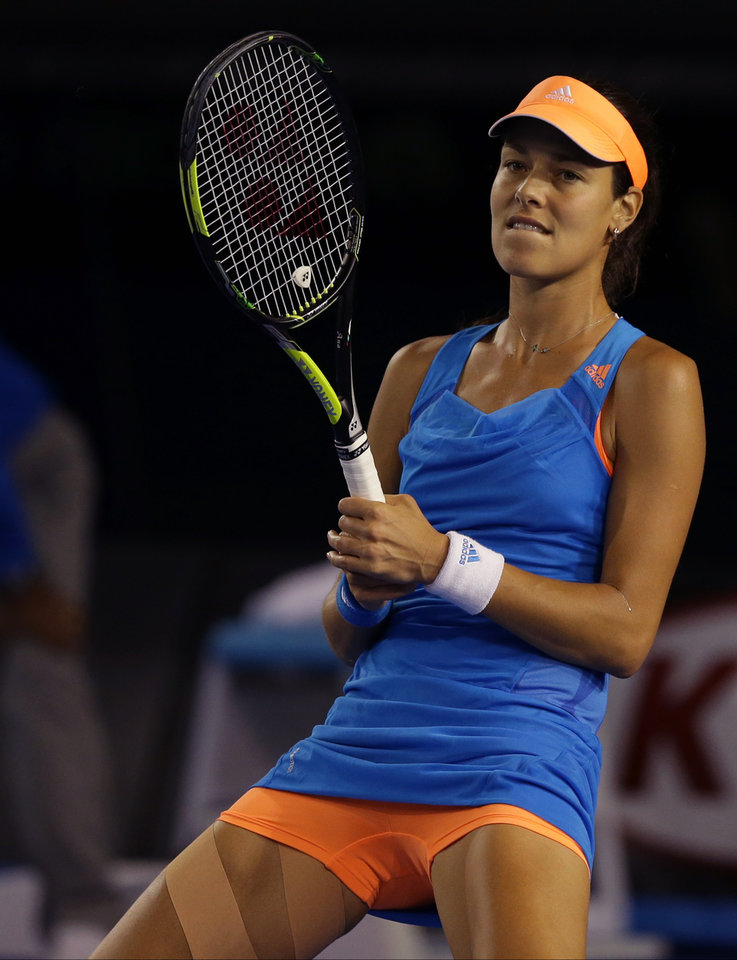 Photo - Ana Ivanovic of Serbia reacts between points as she plays Samantha Stosur of Australia during their third round match at the Australian Open tennis championship in Melbourne, Australia, Friday, Jan. 17, 2014.(AP Photo/Aaron Favila)