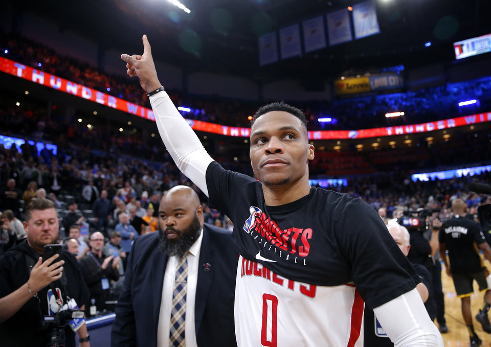 Photo - Houston's Russell Westbrook (0) waves to the crowd following the NBA basketball game between the Oklahoma City Thunder and the Houston Rockets at the Chesapeake Energy Arena in Oklahoma City,  Thursday, Jan. 9, 2020.  [Sarah Phipps/The Oklahoman]