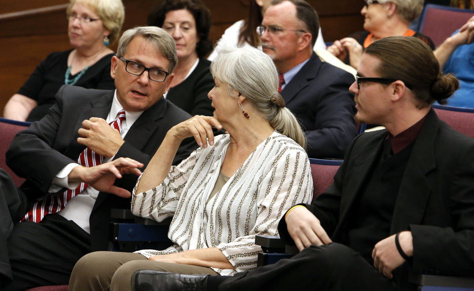 Greg Heiple, Lynne Miller, and Stephen Tyler Holman sit in the audience before they are sworn in as city council members. <strong>STEVE SISNEY - THE OKLAHOMAN</strong>