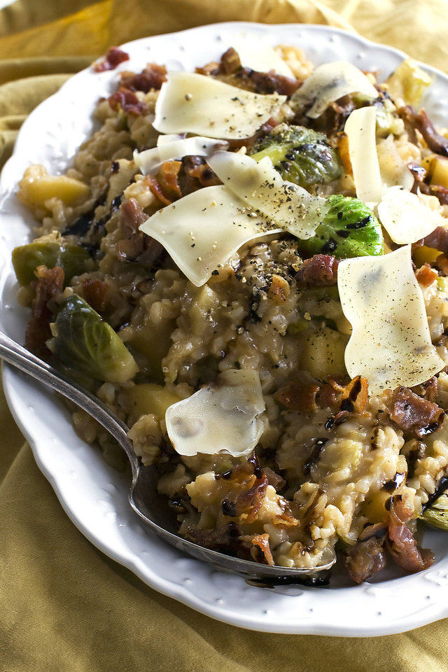 Creamy brown rice risotto two ways: with brussels sprouts and apple. <strong>Matthew Mead - AP</strong>