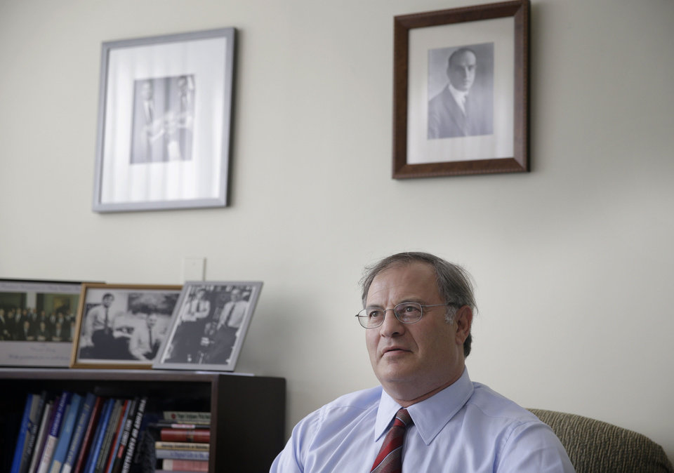 Photo - In this July 9, 2014 photo, economist David Levy poses for picture in his office in Mt. Kisco, N.Y. Levy, who oversees the Levy Forecast, a newsletter analyzing the economy that his family started in 1949, says the United States is likely to fall into a recession next year triggered by downturns in other countries, the first time in modern history. (AP Photo/Seth Wenig)
