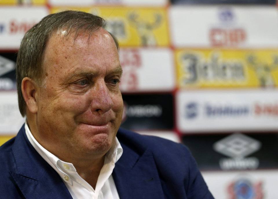 Photo - Newly-appointed Serbian national soccer team coach Dick Advocaat listens during a press conference in Stara Pazova, Serbia, Monday, July 28, 2014. Advocaat signed a two-year contract with Serbia and has the mandate to lead them to the 2016 European Championship in France. (AP Photo/Darko Vojinovic)