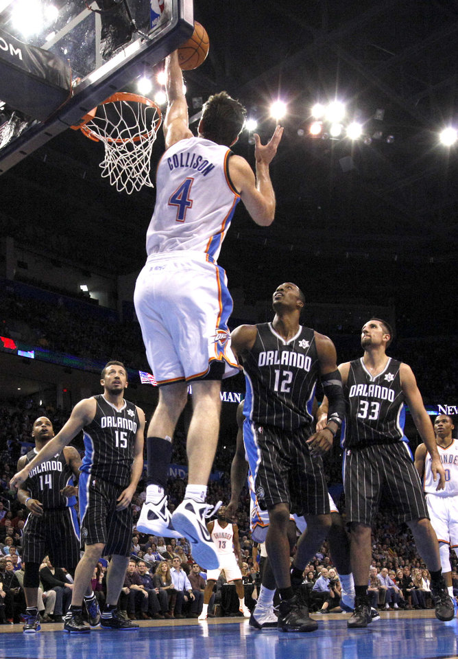 Oklahoma City Thunder\'s Nick Collison (4) dunks in front of Orlando Magic\'s Hedo Turkoglu (15), Dwight Howard (12) and Ryan Anderson (33) during the opening day NBA basketball game between the Oklahoma CIty Thunder and the Orlando Magic at Chesapeake Energy Arena in Oklahoma City, Sunday, Dec. 25, 2011. Photo by Sarah Phipps, The Oklahoman