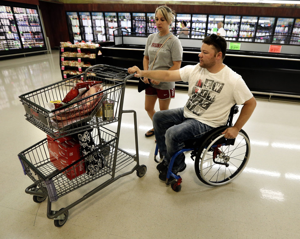 Photo -  EH Pittman and wife, Jean, shop at Crest Market in Norman. Pittman will be honored with a Jim Thorpe Rehabilitation Award on Aug. 22. Photo by Steve Sisney, The Oklahoman   STEVE SISNEY -  THE OKLAHOMAN