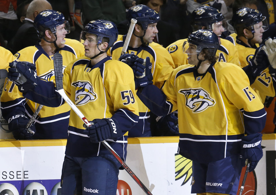 Nashville Predators center Craig Smith (15) and defenseman Roman Josi (59), of Switzerland, celebrate after Smith scored against the Detroit Red Wings during the first period of an NHL hockey game Tuesday, Feb. 19, 2013, in Nashville, Tenn. (AP Photo/Mark Humphrey)
