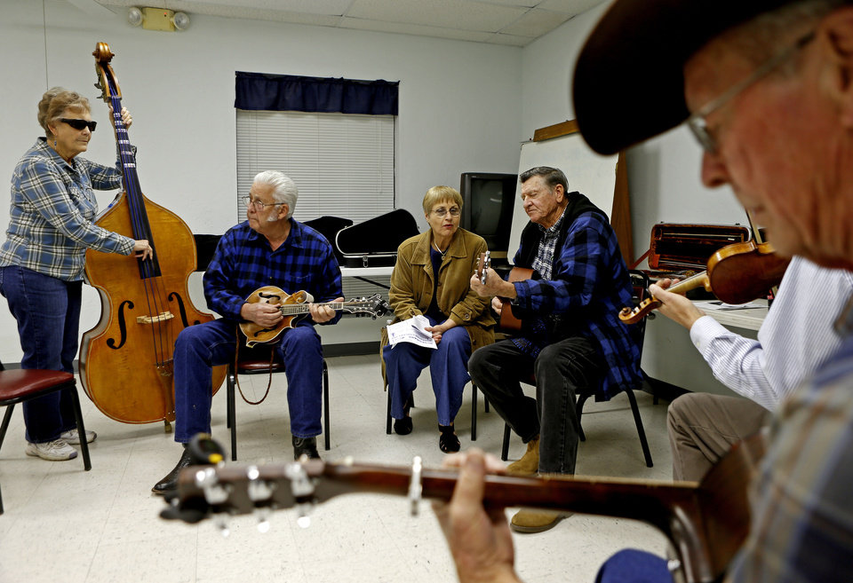 Photo - From left, Betty and Ron Reser, of Shawnee, Jeanne Diaraj, of Norman, and Alton Scott, of Oklahoma City, play during a bluegrass jam session at the Oklahoma Country Western Museum and Hall of Fame in Del City. Photo by Bryan Terry, The Oklahoman  BRYAN TERRY - THE OKLAHOMAN