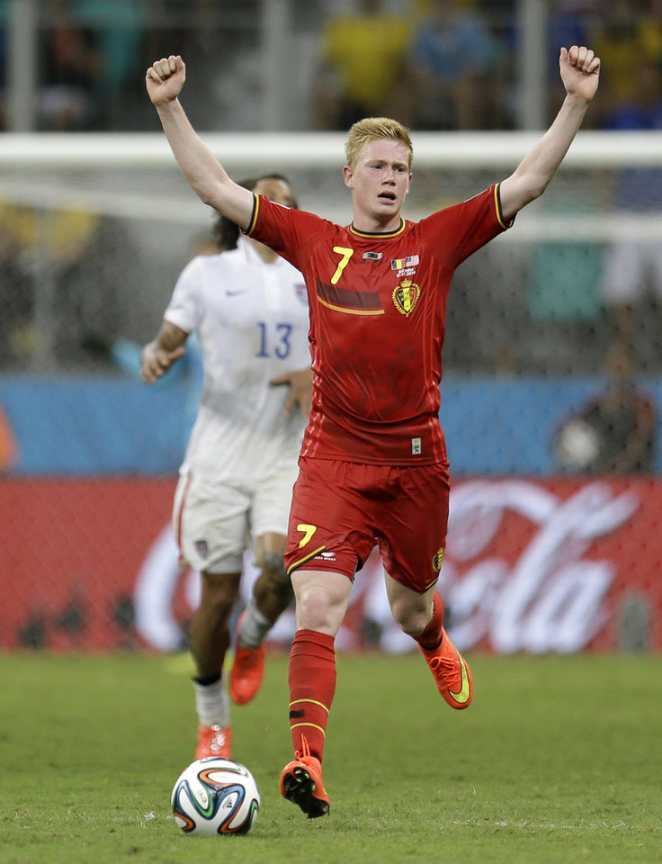 Photo - Belgium's Kevin De Bruyne celebrates as the match ends and Belgium defeated the USA 2-1 in extra time to advance to the quarterfinals during the World Cup round of 16 soccer match between Belgium and the USA at the Arena Fonte Nova in Salvador, Brazil, Tuesday, July 1, 2014. (AP Photo/Natacha Pisarenko)