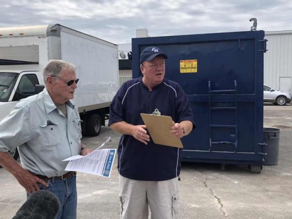 Photo -  Sen. Jim Inhofe, R-Tulsa, talks with El Reno Mayor Matt White on Friday. Inhofe took a helicoptor tour of the tornado damage and said federal assistance would be available in the coming weeks.