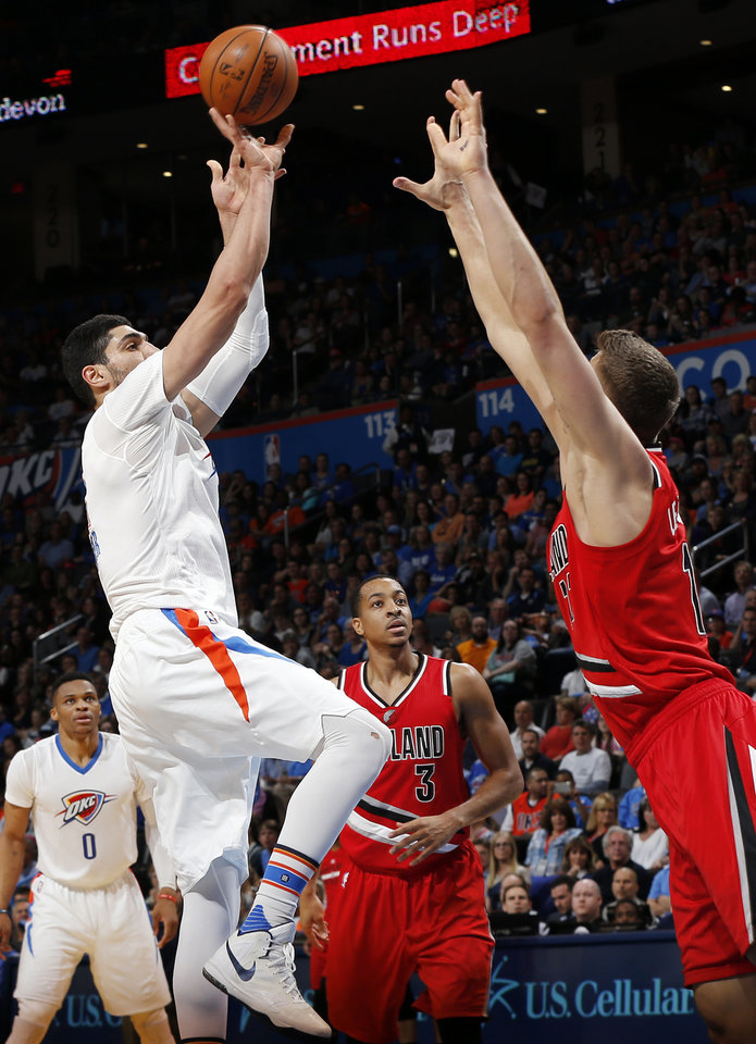 Photo - Oklahoma City's Enes Kanter (11) shoots against Portland's Meyers Leonard (11) during an NBA basketball game between the Oklahoma City Thunder and the Portland Trailblazers at the Chesapeake Energy Arena in Oklahoma City, Monday, March 14, 2016. Photo by Nate Billings, The Oklahoman