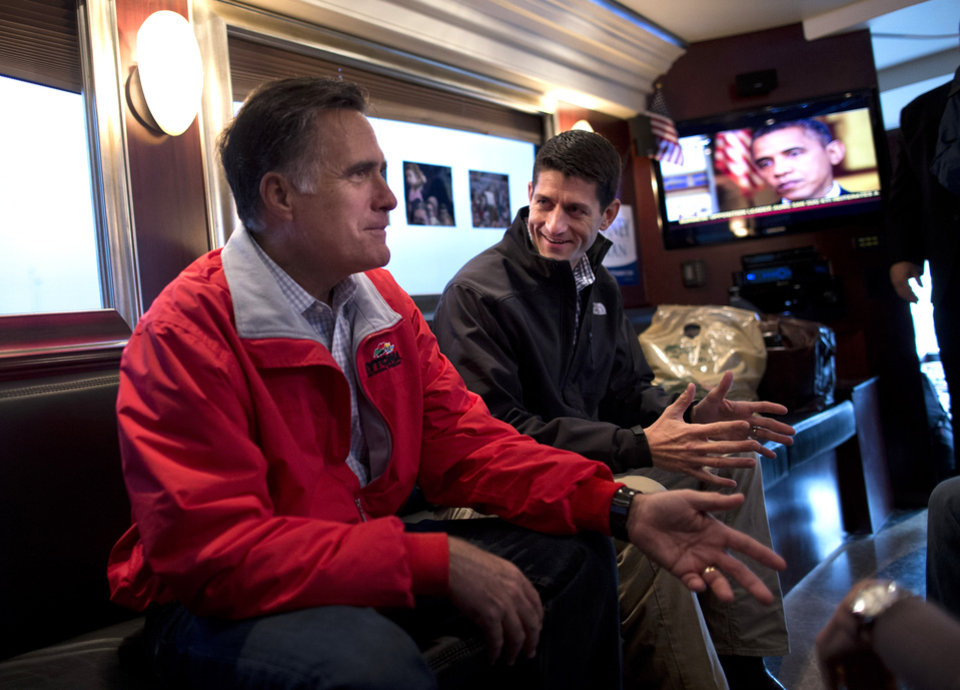 Photo -   Republican presidential candidate, former Massachusetts Gov. Mitt Romney, right, talks with his vice presidential running mate Rep. Paul Ryan, R-Wis., on his campaign bus after a rally on Tuesday, Sept. 25, 2012 in Vandalia, Ohio. (AP Photo/ Evan Vucci)