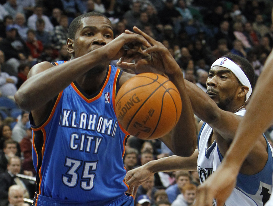 Minnesota Timberwolves guard Corey Brewer, right, strips the ball from Oklahoma City Thunder forward Kevin Durant (35) during the second quarter of an NBA basketball game in Minneapolis, Wednesday, Dec. 8, 2010. (AP Photo/Ann Heisenfelt)