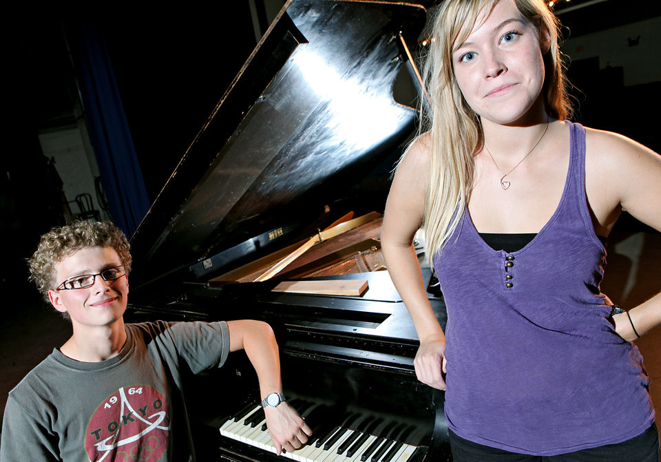 Madeline Bentley and Sam Lower pose with their school's antique piano at Classen SAS in Oklahoma City on Monday, August 23, 2010. The students are raising money to refurbish the piano. Photo by John Clanton, The Oklahoman