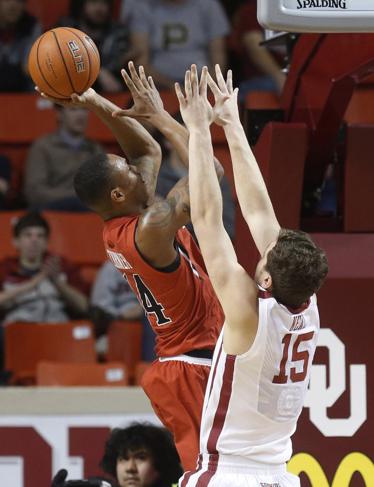Photo - Texas Tech guard Robert Turner (14) shoots in front of Oklahoma forward Tyler Neal (15) during the second half of an NCAA college basketball game in Norman, Okla., Wednesday, Feb. 12, 2014. Texas Tech won 68-60. (AP Photo/Sue Ogrocki)