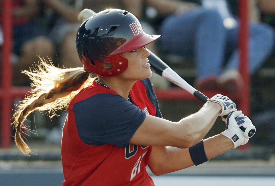 Photo - Jennie Finch hits a three-run home run in her first at-bat against Italy on Friday at ASA Hall of Fame Stadium. (Photo by Nate Billings, The Oklahoman)